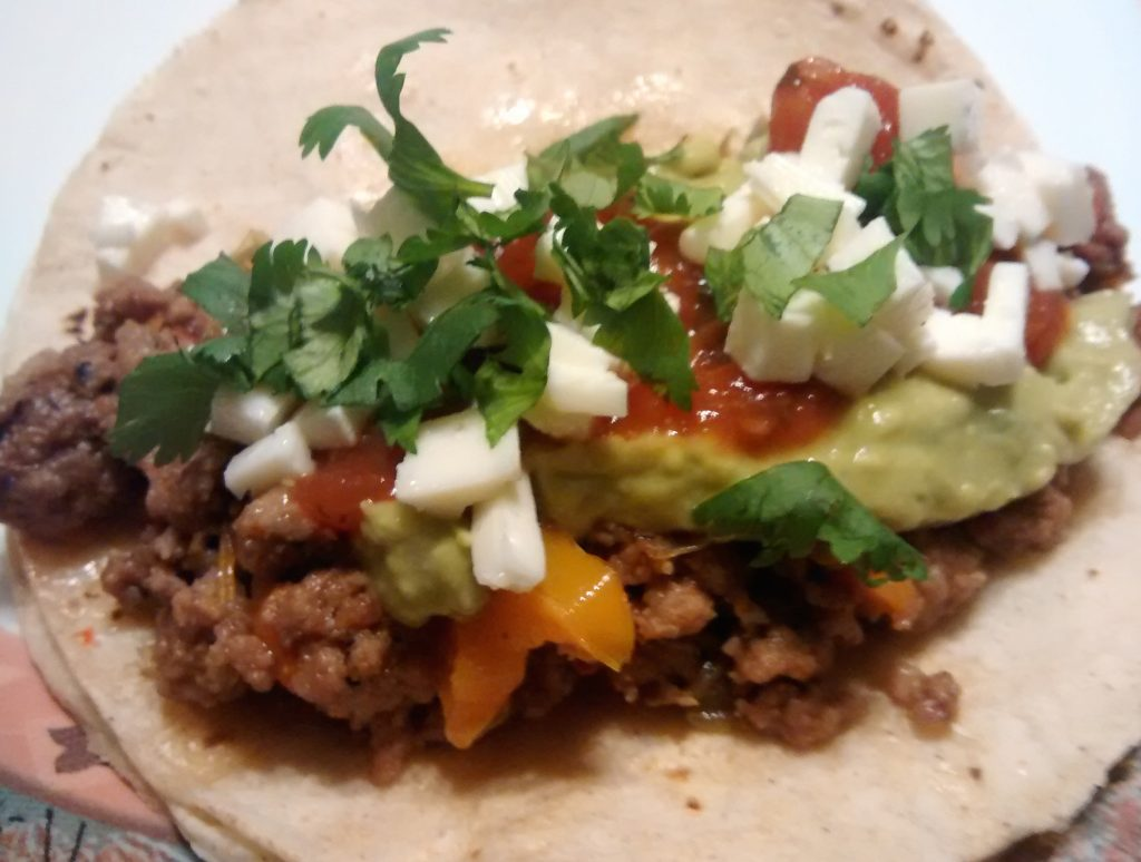 Soft shell taco with veggies and cheese