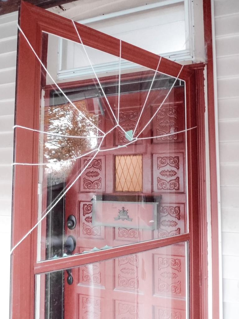 This is an easy step-by-step tutorial on how to make a Halloween spider door