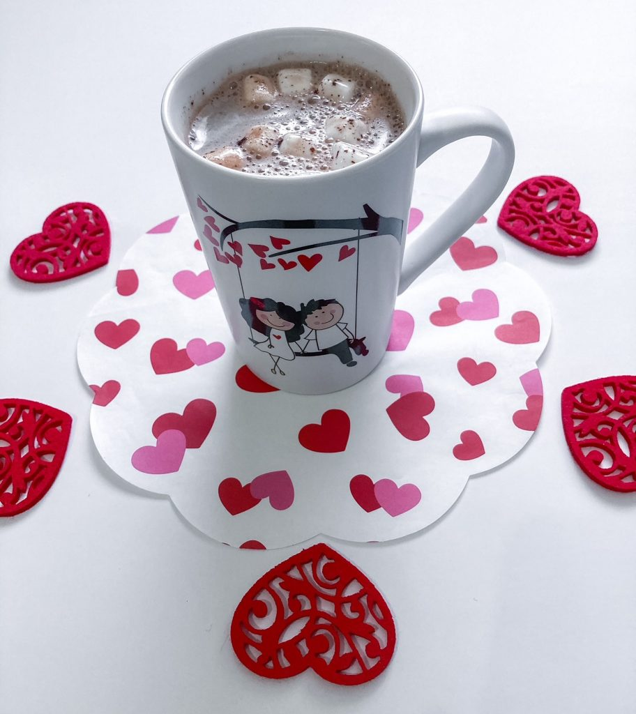 Hot cup of milk with chocolate bomb