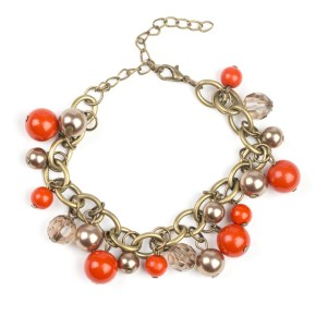 Antique gold bracelet with clear and orange beads