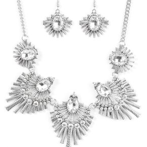 Textured metal bars flare out from a mesmerizing gem, creating a fringe of fanning frames. Sprinkled with matching white rhinestones, the dazzling display falls just below the collar for a sassy finish. Features an adjustable clasp closure.