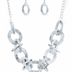 Brushed in a faux-marble finish, bold links connect below the collar for a statement making look. Features an adjustable clasp closure. Sold as one individual necklace. Includes one pair of matching earrings.