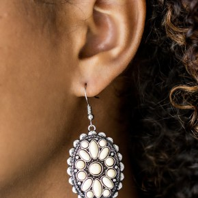 Varying in shape, refreshing white stones are pressed into a textured silver frame, creating a whimsical floral pattern. Earring attaches to a standard fishhook fitting. Sold as one pair of earrings.