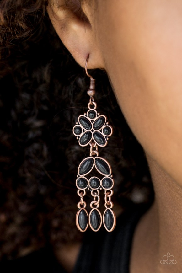 Chiseled into round, oval, and marquise shapes, smooth black stones are pressed into a stacked copper lure for a whimsical western look. Earring attaches to a standard fishhook fitting. Sold as one pair of earrings.