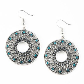 Dotted in dainty blue rhinestones, glistening silver wires twist and interlock inside of a shimmery silver hoop for a whimsical look. Earring attaches to a standard fishhook fitting. Sold as one pair of earrings.