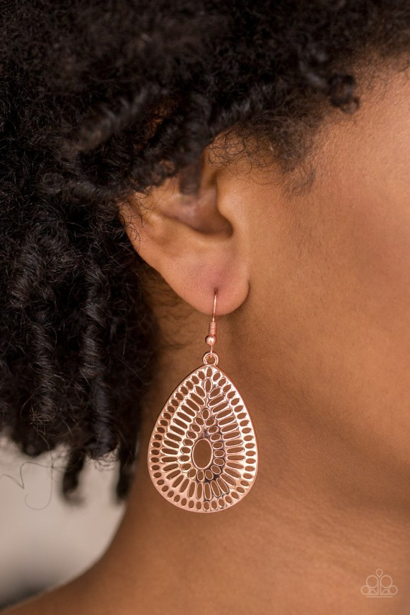 Rippling with grate-like stenciled detail, a shiny copper teardrop frame swings from the ear for a seasonal look. Earring attaches to a standard fishhook fitting. Sold as one pair of earrings.