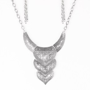 Stamped in whimsical floral patterns, studded silver plates link below the collar for a fierce look. Features an adjustable clasp closure. Sold as one individual necklace. Includes one pair of matching earrings.