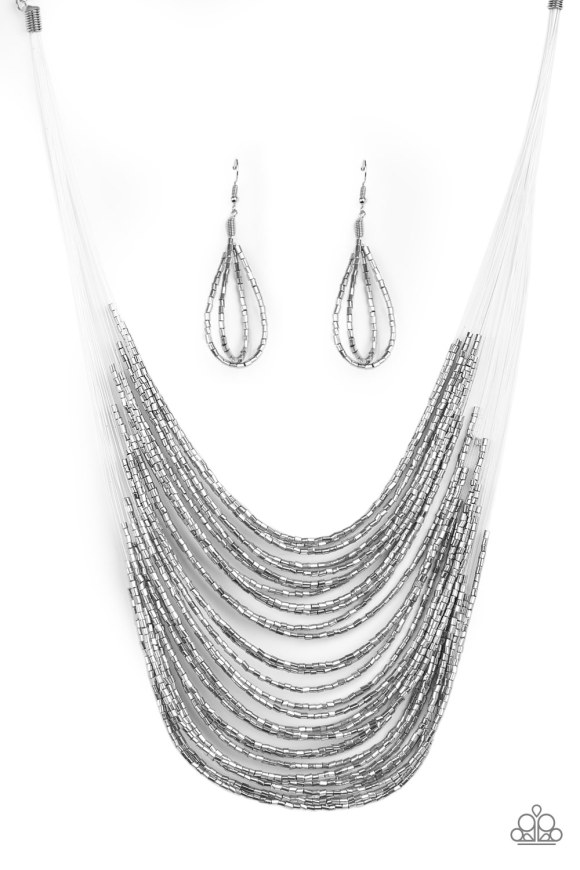 Strand after strand of metallic silver seed beads fall together to create a bold statement piece. Features an adjustable clasp closure. Sold as one individual necklace. Includes one pair of matching earrings.