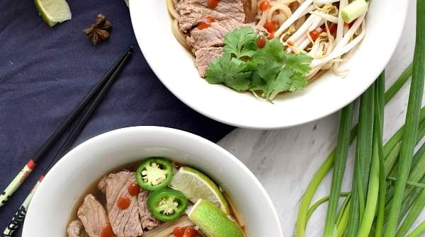 Overhead shot of 2 bowls of beef pho