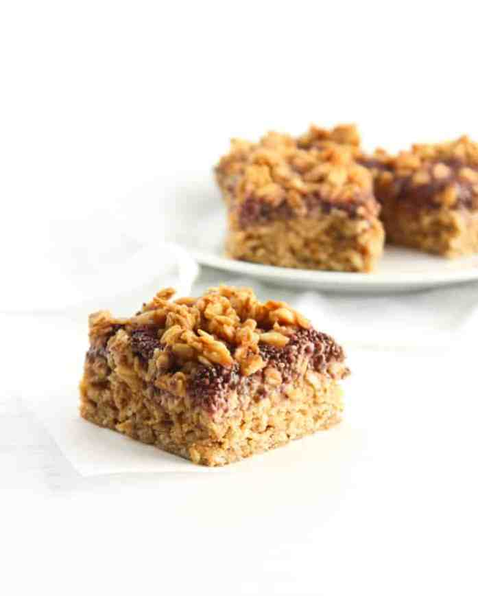 healthy to go pb&j baked oatmeal bar sitting on a with parchment paper