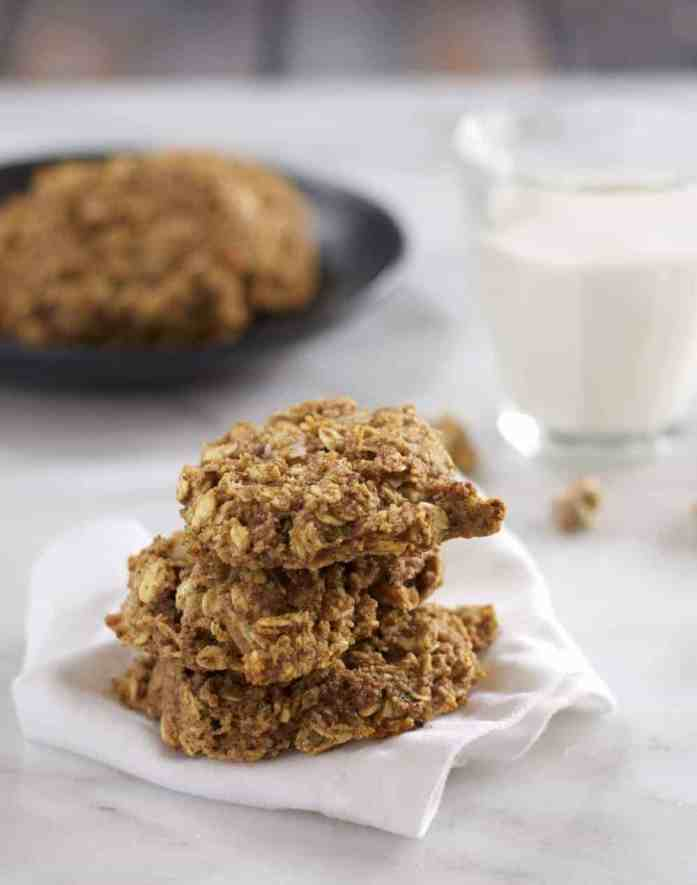 healthy to go banana oatmeal breakfast cookies in a stack with a glass of milk