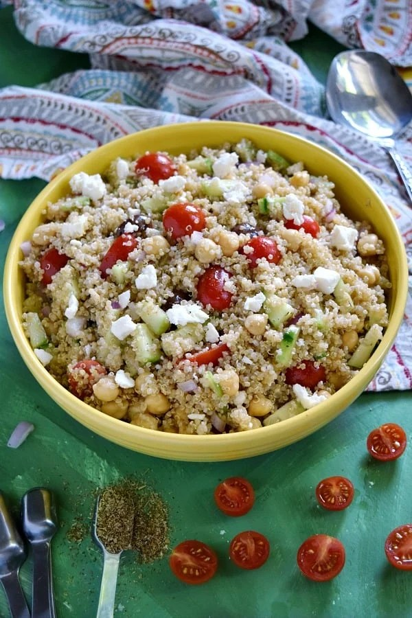 Greek Quinoa Chickpea Salad in a yellow bowl ready to be eaten
