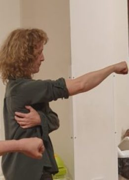 Stage combat expert Alison de Burgh, throwing a punch