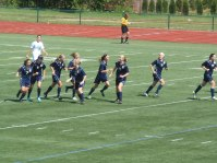 Team celebrating a quick goal scored by senior Madison Schupbach.