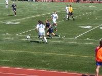 Junior Maria Zandi trying to get the ball away from an Eisenhower midfielder.