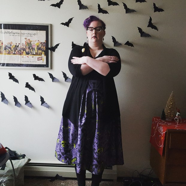 A woman wearing the Marnie skirt in grey gothic by Lindy Bop