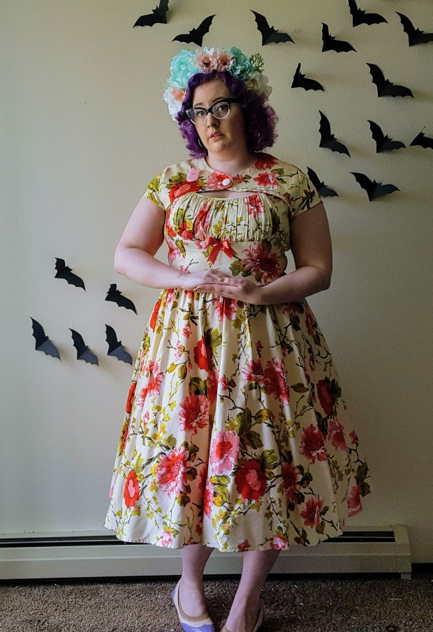 Plus size woman wearing floral dress and flower crown