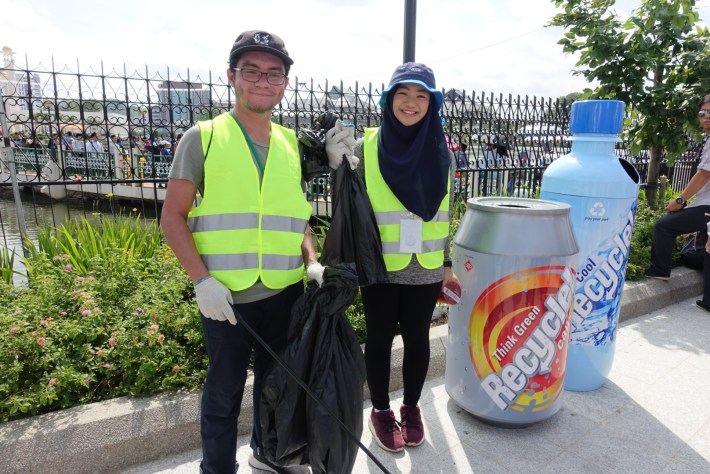 Affan Zain (L) and Zaahidah Iskandar volunteering to keep the Taman Mahkota Jubli Emas clean during its launching today.