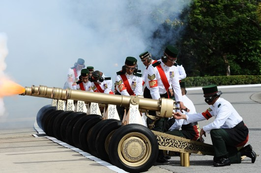 Canons fire a 21-gun salute before His Majesty inspects a ceremonial guard of honour at Istana Nurul Iman. Photo: Infofoto