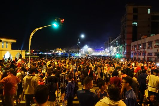 Thousands of people mill around the streets of Bandar Seri Begawan on Oct 14, to witness the opening of the Raja Isteri Pengiran Anak Hajah Saleha Bridge. Photo: Rachel Thien