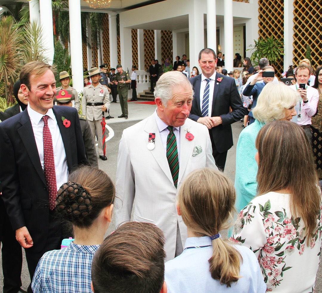 Prince Charles speaks with students of International School Brunei during a meet-and-greet with the British community at Istana Edinburgh. Photo: Ain Bandial/The Scoop