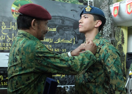 HM the Sultan presents the Air Wing Badge to his son, HRH Captain Prince 'Abdul Mateen. Photo: Infofoto