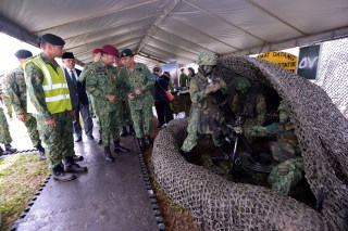 HM the Sultan tours the static display at Penanjong Garrison during the RBAF's 57th anniversary, July 1, 2018. Photo: Infofoto