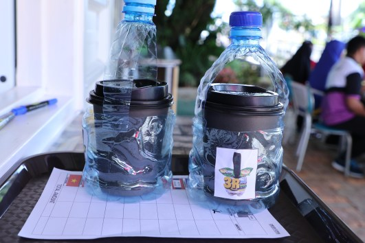 Repurposed plastic bottles turned into coffee cup carriers at the SMARTER Brunei Cafe & Bistro. Photo: Rasidah HAB/The Scoop