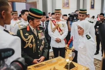HM the Sultan receives a 'pesambah' from newly-commissioned officer cadets on January 17, 2019. Photo: Hazimul Harun/The Scoop