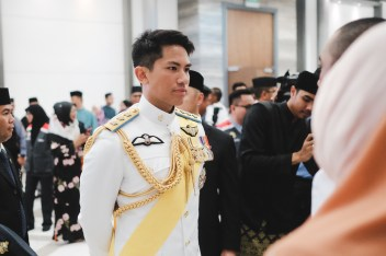 HRH Prince 'Abdul Mateen mingling with freshly commissioned officer cadets and their families after the Sovereign's Parade on January 17, 2019. Photo: Hazimul Harun/The Scoop