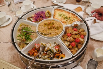 Omani dishes being served as the main course for the Omani Cultural Night. Photo: Hazimul Wa'ie/The Scoop