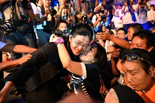 Pheu Thai party's candidate for prime minister Sudarat Keyuraphan (L) is hugged by a supporter during the party's final major campaign rally in Bangkok on March 22, 2019, ahead of the March 24 general election. Photo: Ye Aung Thu/AFP