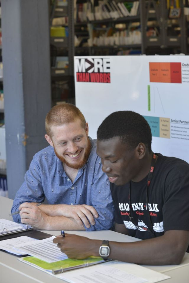 Jon Luc (right) evaluates his progress and receives feedback before and after each shift at the bookstore on East Berkeley Street. Photo courtesy of More Than Words.
