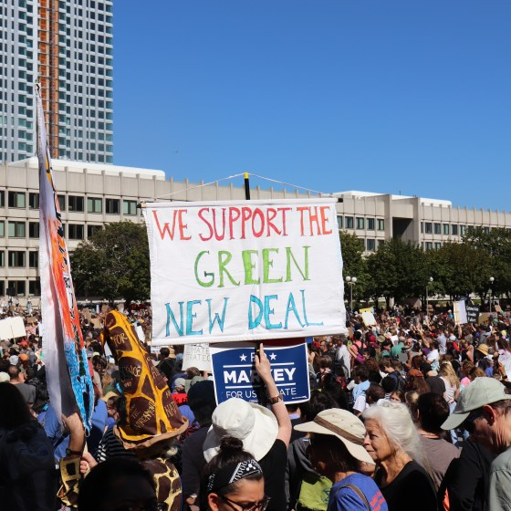 "Protestors referred to themselves as ""Generation Green New Deal."" Photo by Eileen O'Grady."
