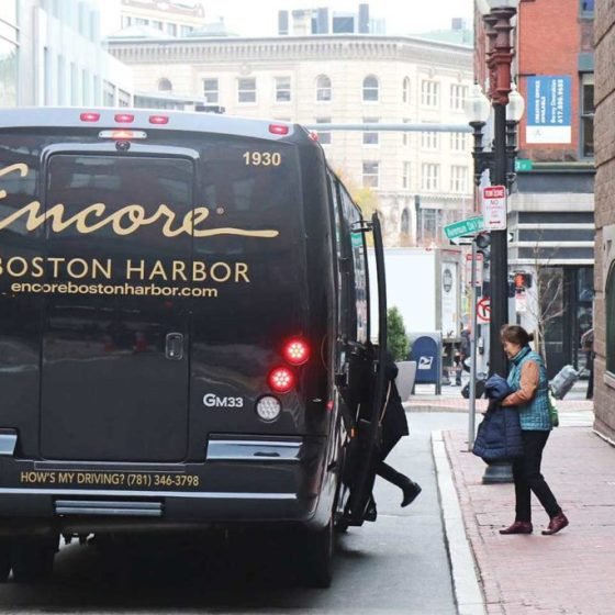 Shuttle buses such as this one from Encore Casino regularly pick up customers from Chinatown and other low-income communities. Photo by Eileen O'Grady.