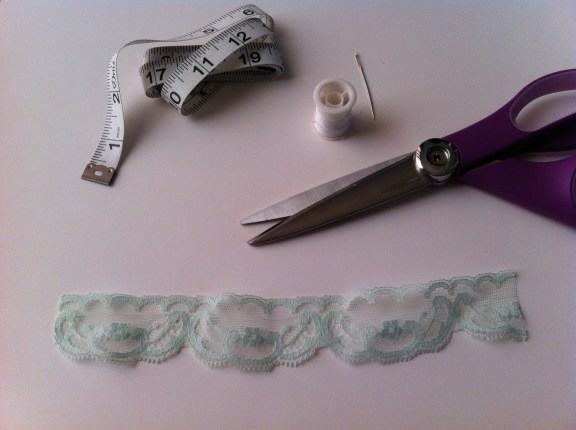 You'll need about 1 foot of lace, scissors, thread, a needle, and a measuring tape.