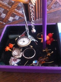 #10: Use a jewelry tree's lower compartment to hold pretty rings, earrings, pendants, or watches.