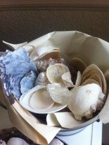 #8: Use a metal basket lined with with either newspaper or butcher paper, then fill it with shells.