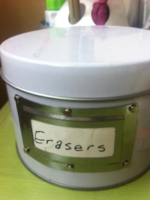 #13: Use metal containers with label slots to hold erasers, beads, paper clips, or pins for sewing.