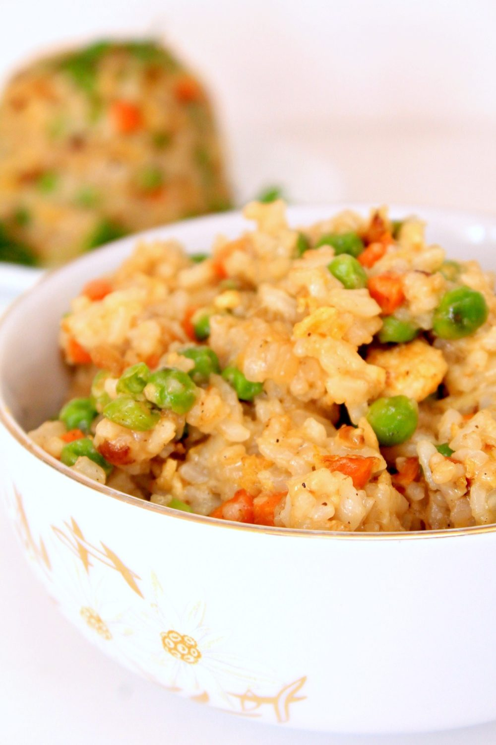 Image of vegetable egg fried rice recipe in a white bowl