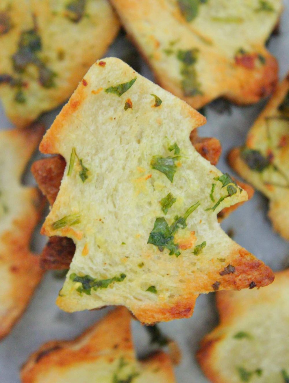 Garlic bread chips cut in the shape of Christmas tree