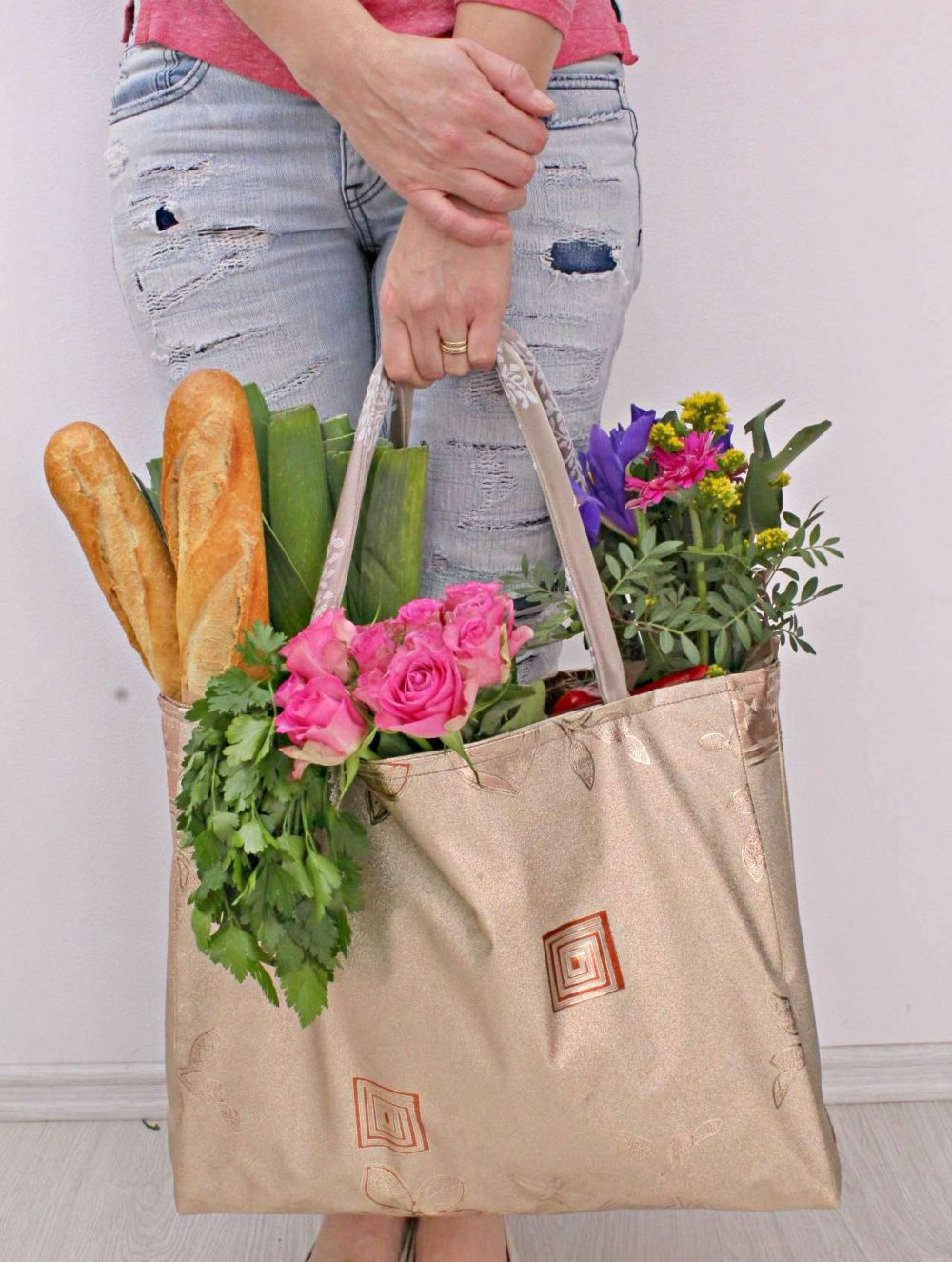 Shopping bag pattern for a vinyl tote bag, filled with flowers herbs and bread