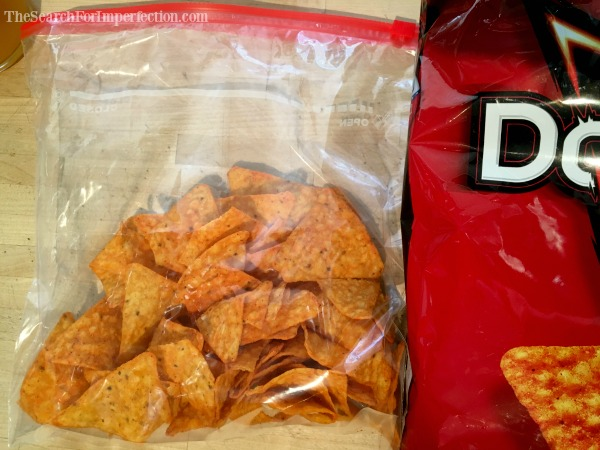 First step, put the Doritos in a bag.