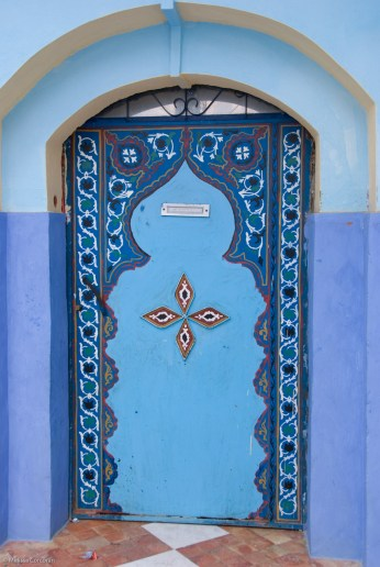 Another beautifully decorated door.