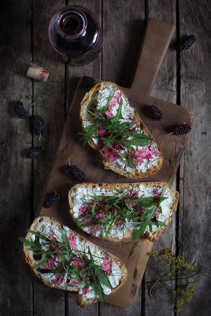 Mulberry, Goats Cheese, Rocket Leaf and Fennel Toasts -- https://theseasonaltable.co.uk/savoury/mulberry-goats-cheese-rocket-leaf-fennel-toasts/