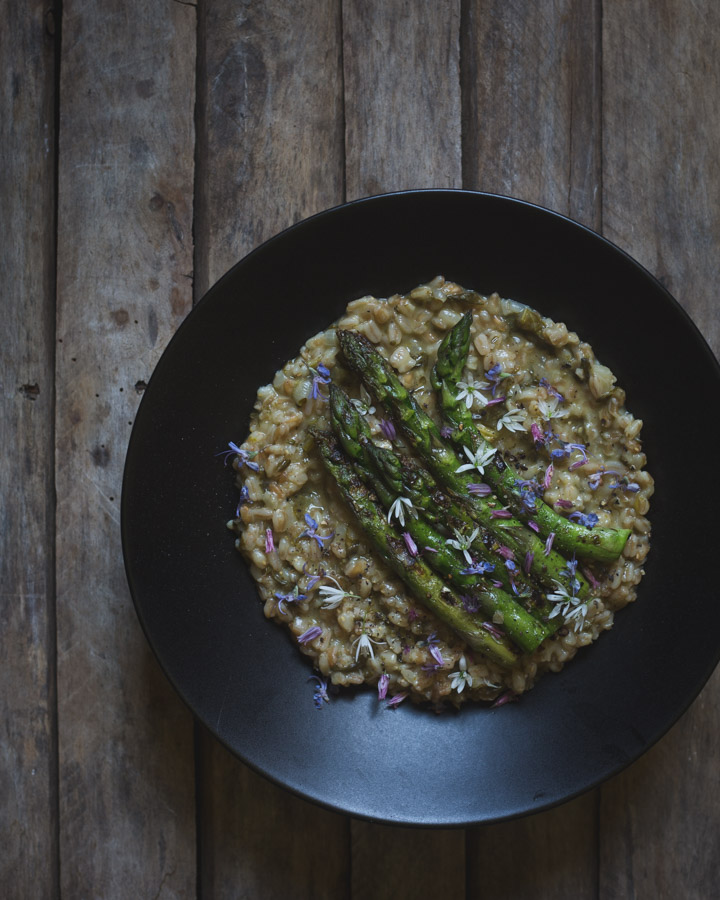 Spelt Risotto with Sorrel, Asparagus, and Herb Flowers -- https://theseasonaltable.co.uk/savoury/spelt-risotto-with-sorrel-asparagus-and-herb-flowers/