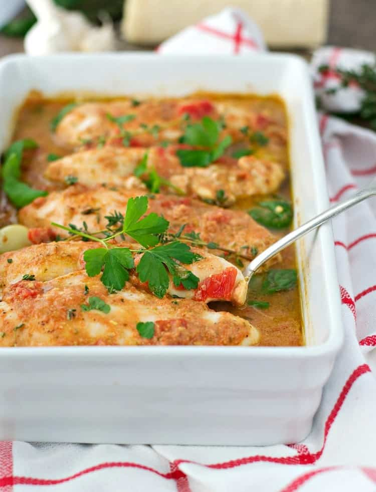 Work Italian Baked Chicken is a fast, healthy, and easy dinner that cooks in its own garlic and herb pan sauce!