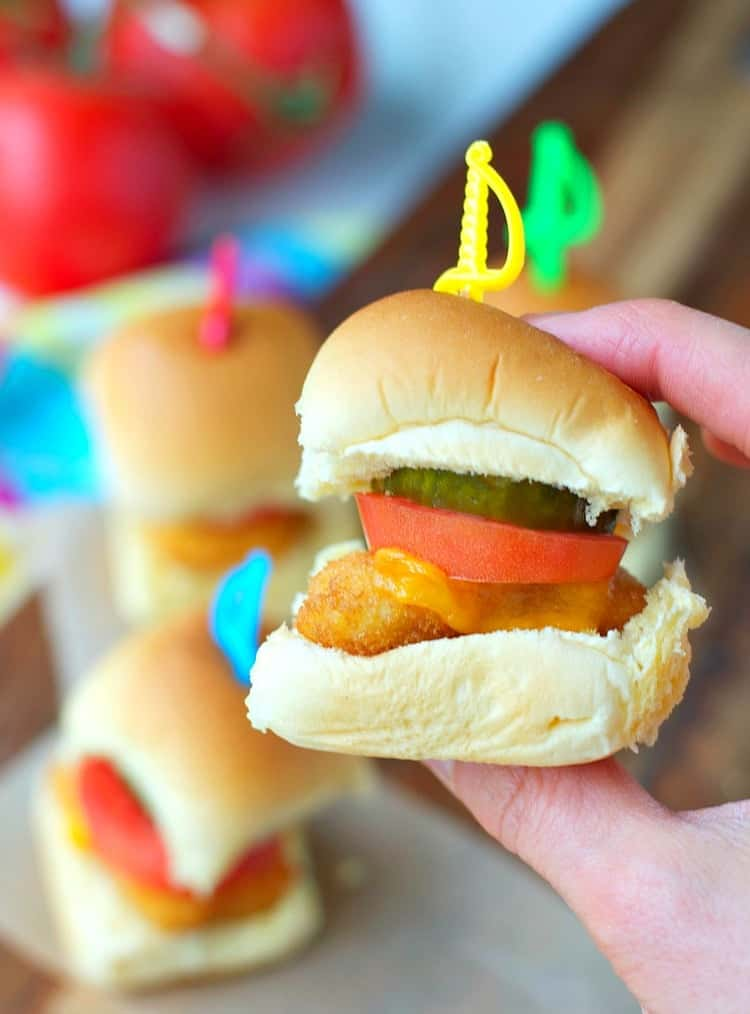 Football season is almost here and I have the perfect game day snacks to share today. Nothing makes a crowd of hungry fans happier than these 3-ingredient Chicken Nugget Sliders -- an easy appetizer that's sure to be a touchdown at your next tailgate party!