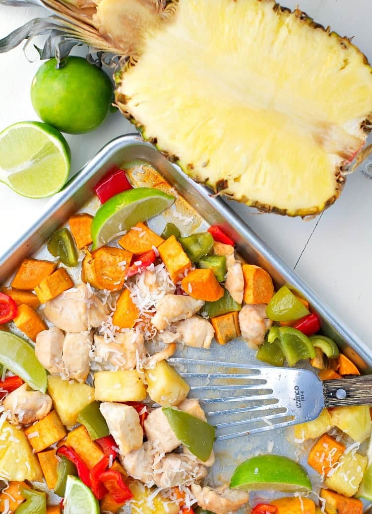 This Hawaiian Chicken with Sweet Potatoes, Peppers, and Pineapple is an easy dinner that cooks entirely on one tray! It's a healthy Sheet Pan Supper that the whole family will love -- with only a few dishes to wash at the end!