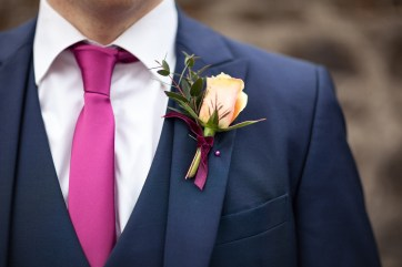 rose and red velvet buttonhole